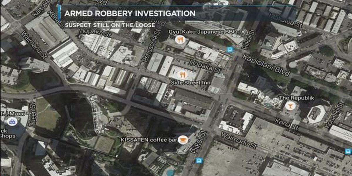 Authorities seek suspect in armed robbery at Honolulu bar