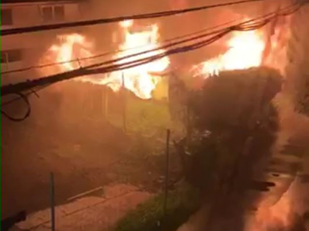 Honolulu firefighters responding to a 2-alarm building fire in Kalihi
