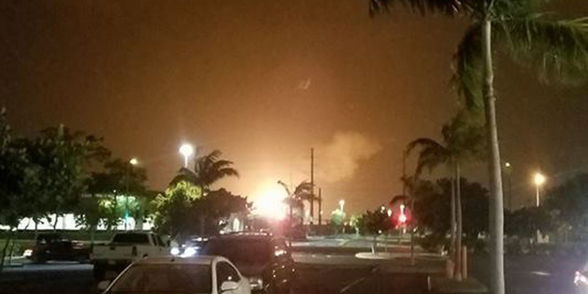 Partial shutdown of oil refinery causes bright gas flare seen for miles