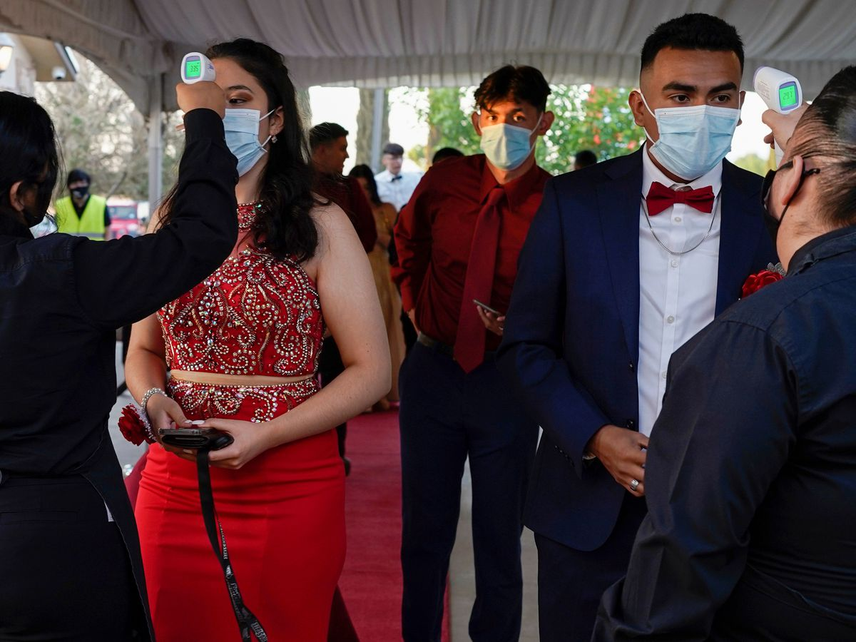 Some proms are back, with masks, testing and distancing