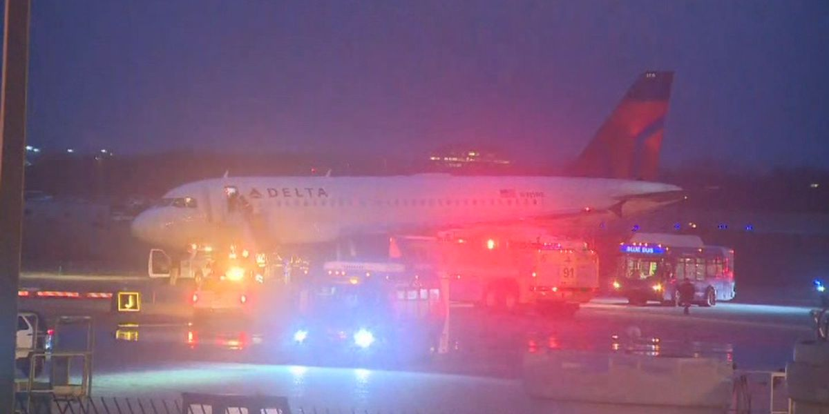 Plane slides off taxiway in icy weather as storm hits US