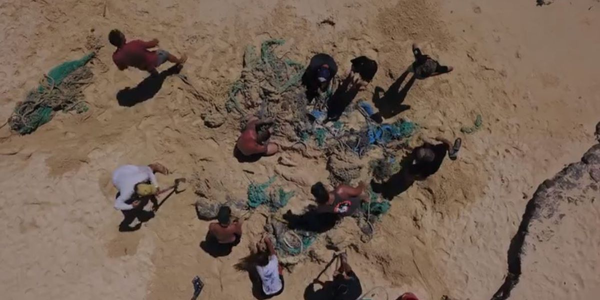 Volunteers spend hours removing 4,000-pound 'ghost net' from Oahu beach