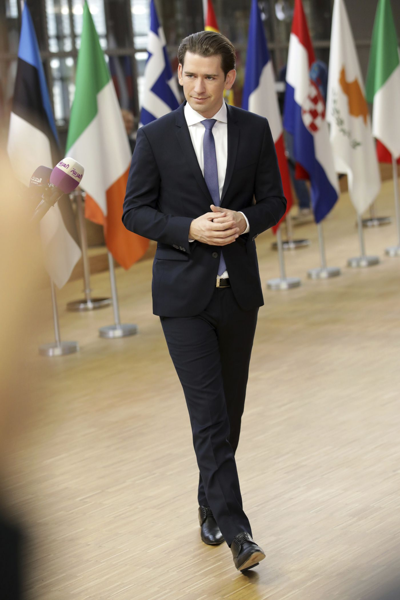 Austrian Chancellor Sebastian Kurz speaks with the media as he arrives for an EU summit at the Europa building in Brussels, Thursday, Oct. 18, 2018. EU leaders meet for a second day on Thursday to discuss migration, cybersecurity and to try and move ahead on stalled Brexit talks. (AP Photo/Olivier Matthys)