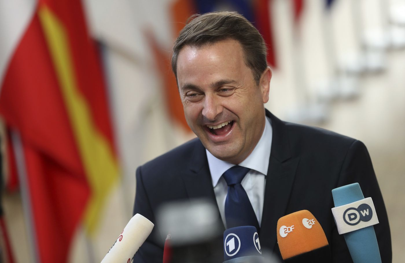 Luxembourg's Prime Minister Xavier Bettel speaks with the media as he arrives for an EU summit at the Europa building in Brussels, Thursday, Oct. 18, 2018. EU leaders meet for a second day on Thursday to discuss migration, cybersecurity and to try and move ahead on stalled Brexit talks. (AP Photo/Francisco Seco)