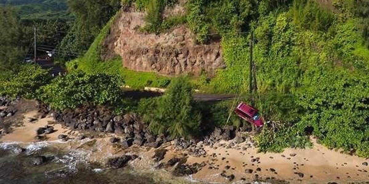 2 vehicles drive off road onto rocky shoreline on Kauai