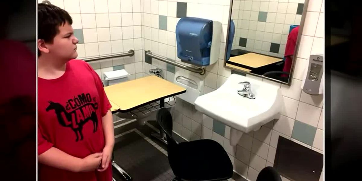 Desk of student with special needs put in bathroom