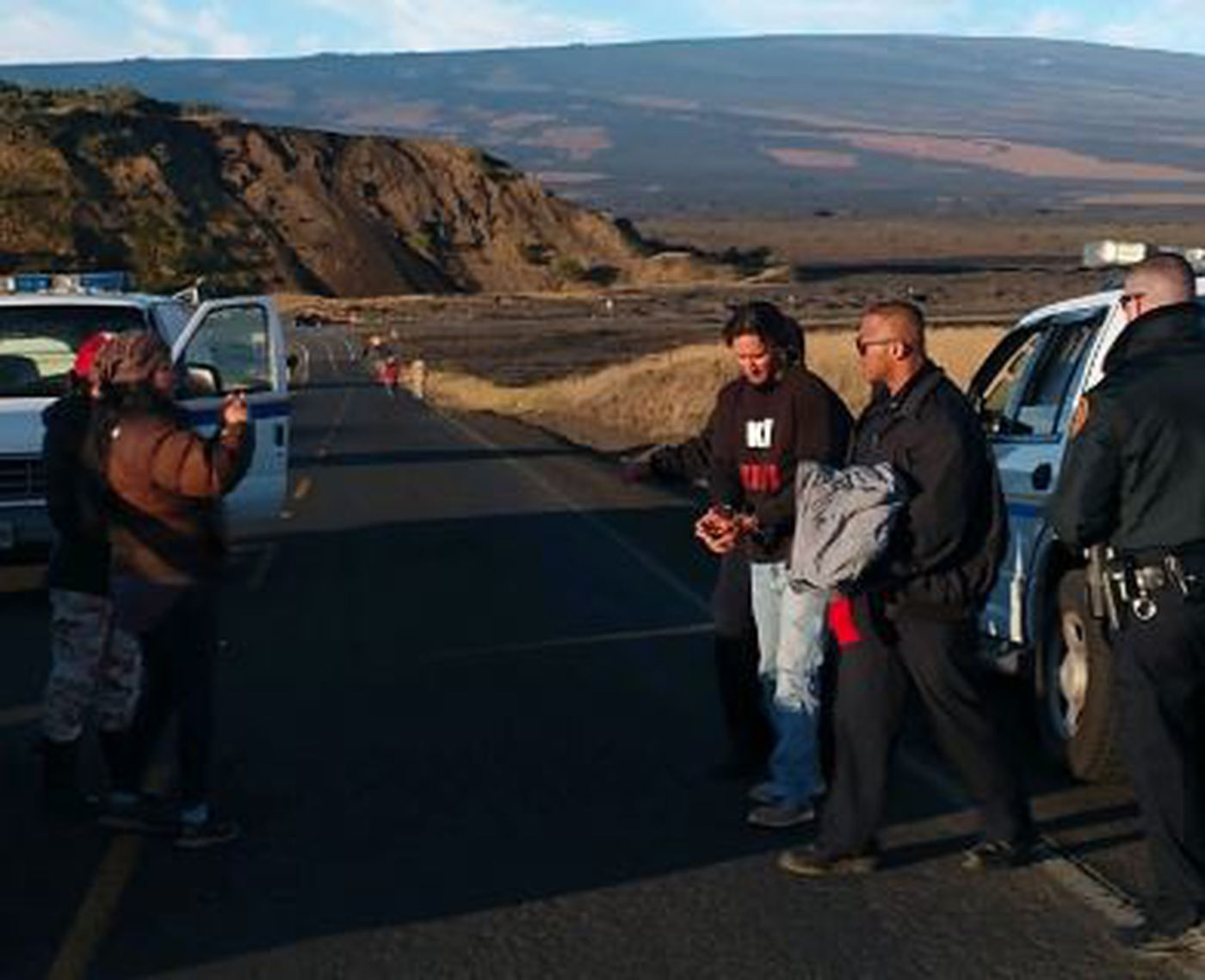 Officers arrested Kahookahi Kanuha on Thursday morning atop Mauna Kea in an apparent sign that construction of the TMT project is ramping up. (Image: Jennifer Ruggles)