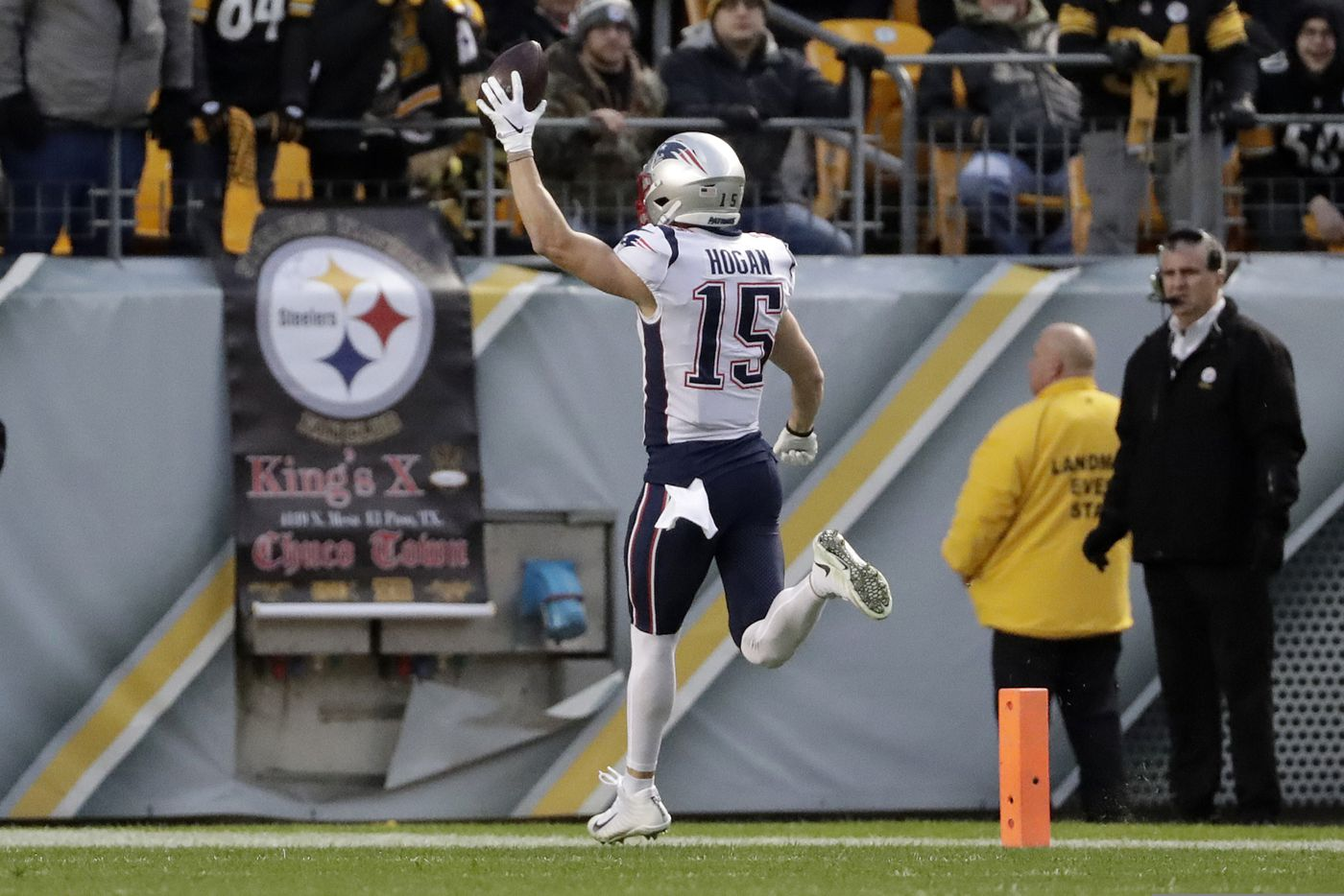 3ab74c2c265 New England Patriots wide receiver Chris Hogan (15) scores after taking a  pass from