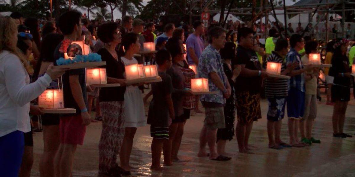 'Peace': A sea of lanterns illuminates Ala Moana Beach to honor loved ones lost