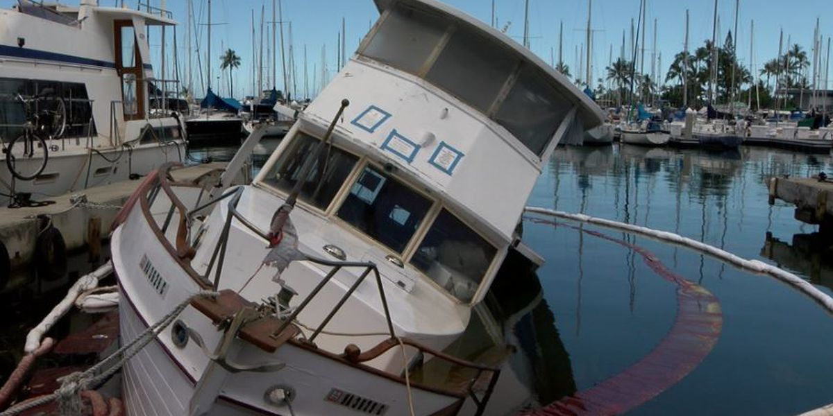 Abandoned boat spills oil into the Ala Wai Harbor