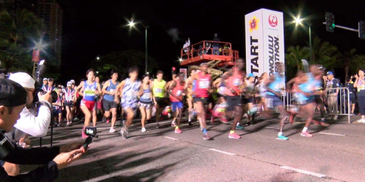 PHOTOS: Thousands of runners cross the Honolulu Marathon finish line, despite gusty winds
