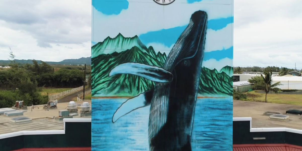 Artist Wyland completes mural at iconic Kauai Village clock tower