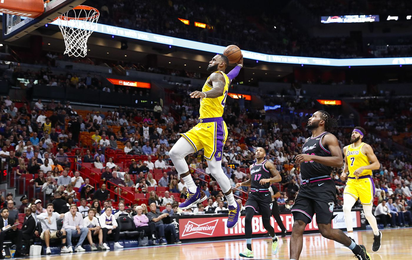 Los Angeles Lakers forward LeBron James scores during the first quarter of an NBA basketball game