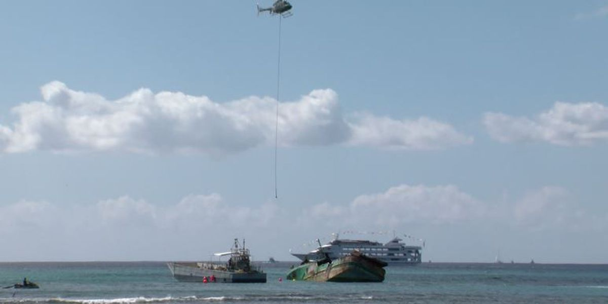 Chopper used to lighten load of stranded Waikiki ship before removal