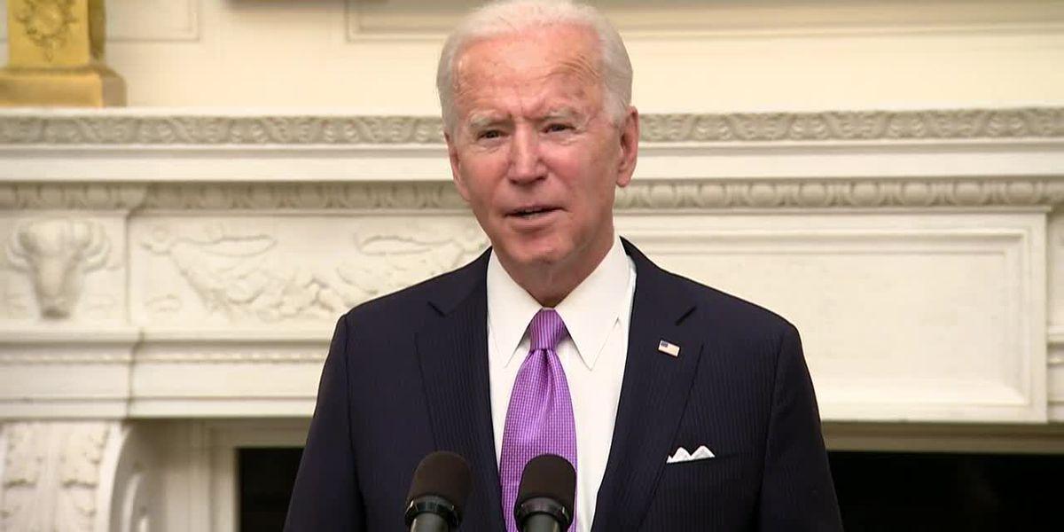Biden signs burst of virus orders, requires masks for travel