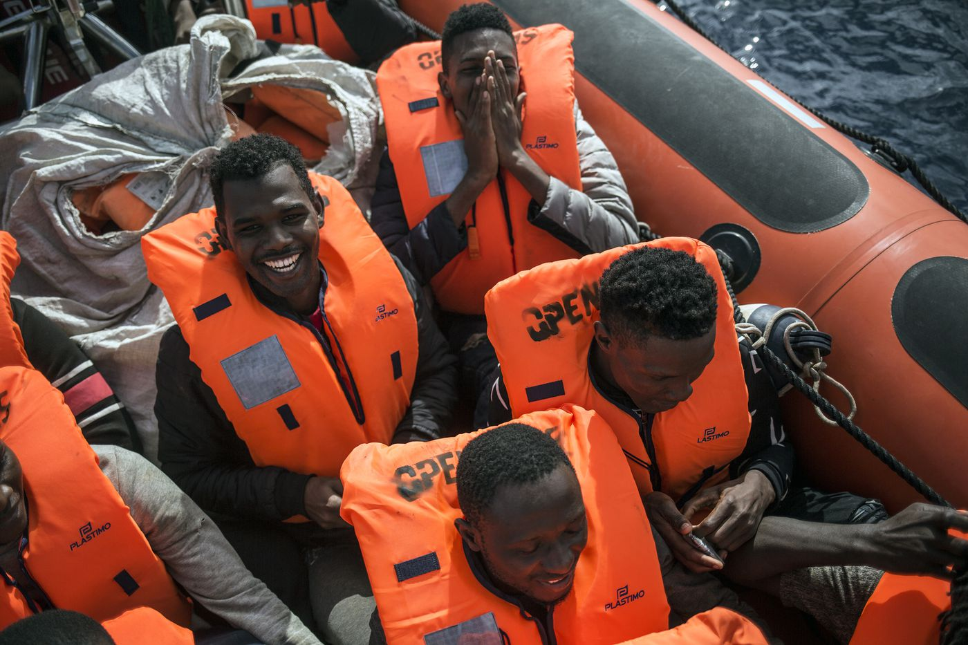 Migrants celebrate on a rescue boat from the Spanish NGO Pro activa Open Arms after being spotted and rescued them at Alboran Sea, about 40 miles (64 kms) from the Spanish coasts, on Thursday, Oct. 11 2018. The Open Arms is now based at Motril port in order to start operating in the western Mediterranean area. (AP Photo/Javier Fergo)