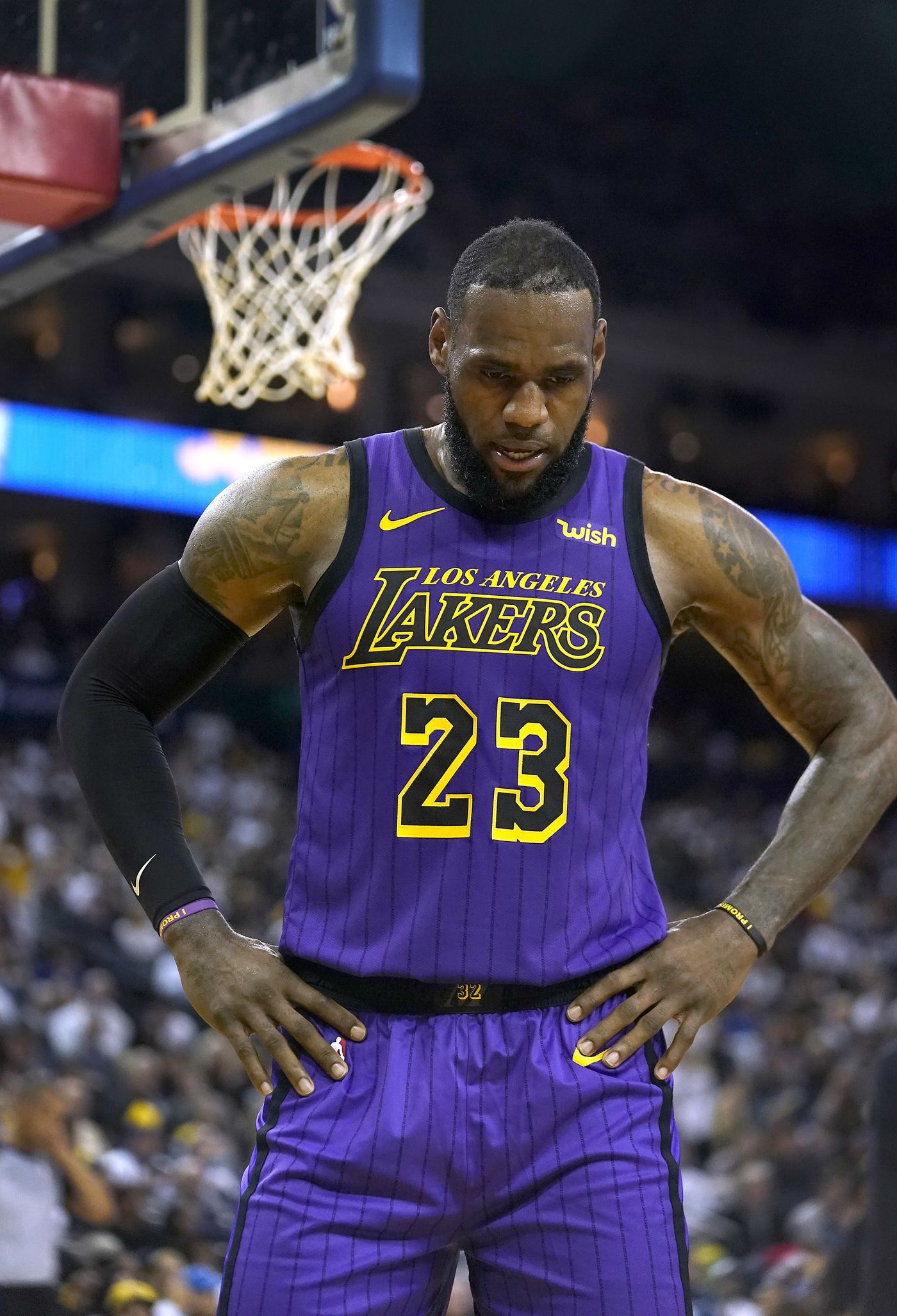 de6dc9e5073 Los Angeles Lakers forward LeBron James walks off the court after straining  his left groin during