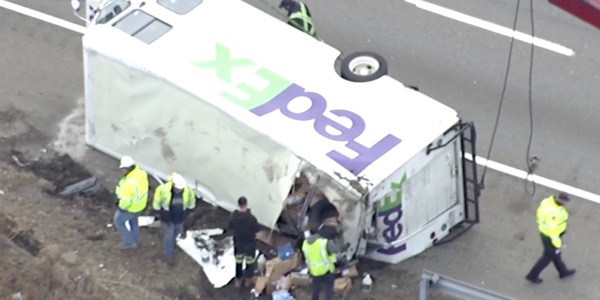 Packages spill after FedEx truck overturns on MA highway