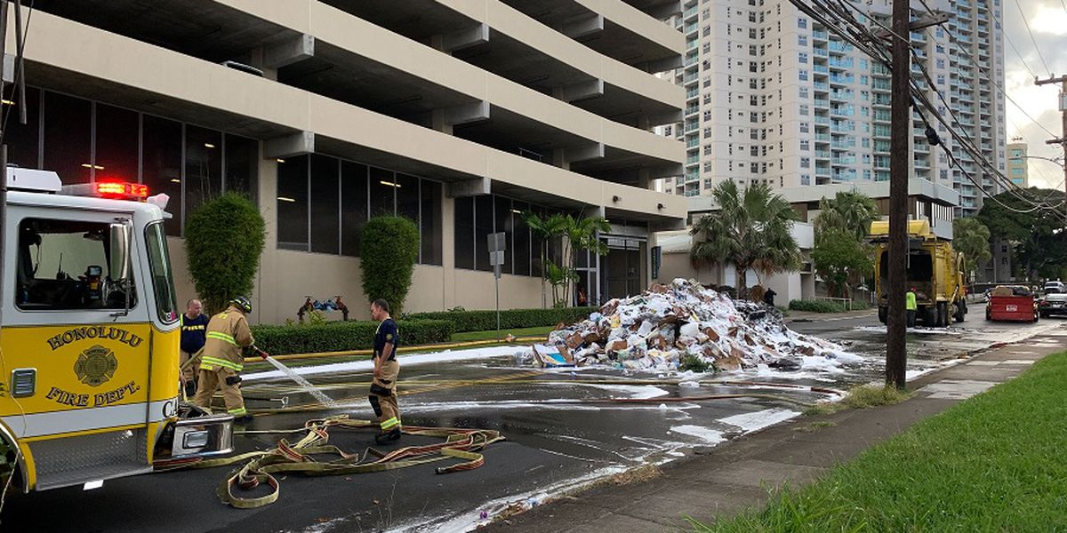A fire in a garbage truck makes a big (stinky) mess