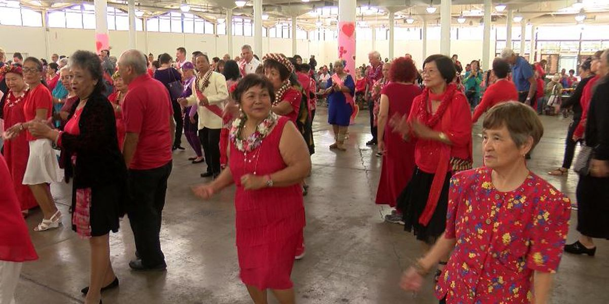 Feeling the love: Hundreds of senior citizens boogie down at annual Valentine's dance