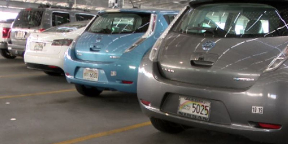 Electric vehicles get free parking at airports. Officials wonder: Is that fair?