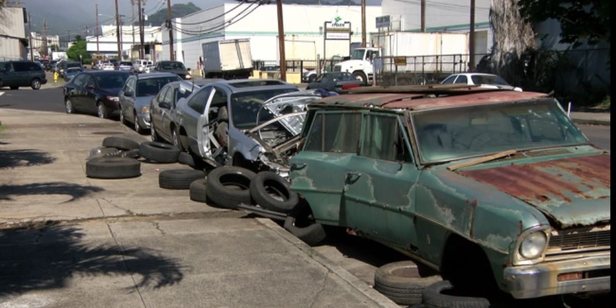 Kalihi businesses fed up with the illegal dumping of derelict cars