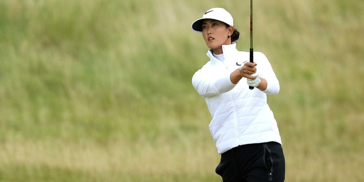In-Kyung Kim handles bad weather to take British Open lead; Wie falters