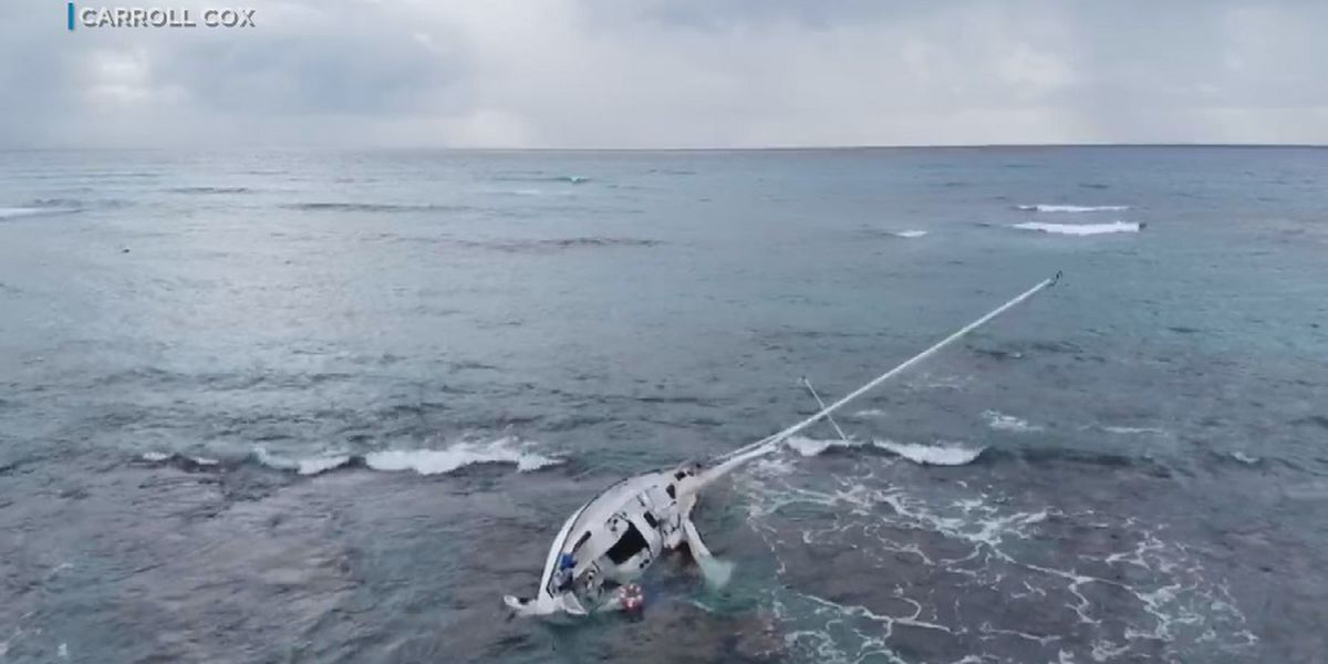 Salvage crews work to remove grounded sailboat off Kaimana Beach