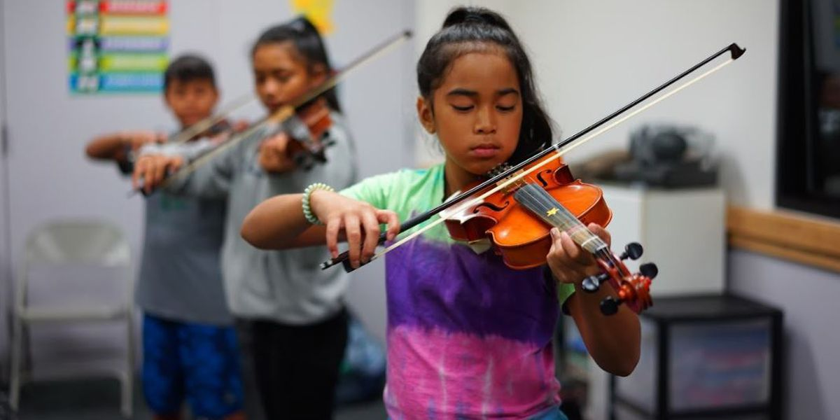 Nanakuli youngsters learn a 4-stringed instrument that isn't the ukulele