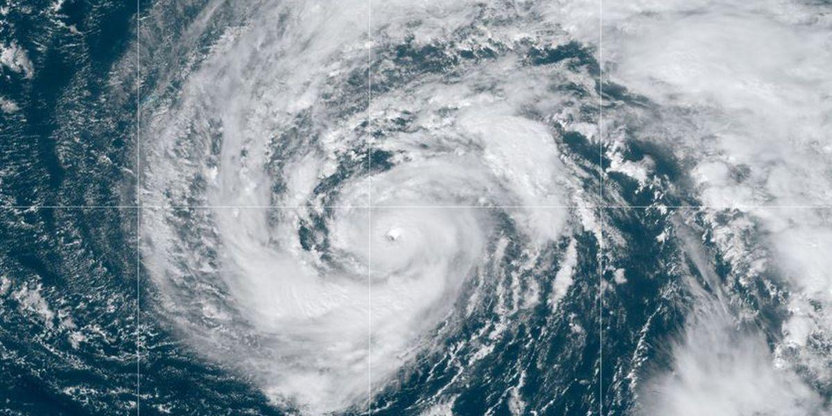 Weakened Hurricane Epsilon moves north over Atlantic Ocean