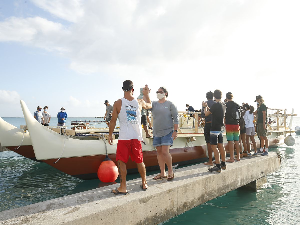 Following lengthy dry dock, Hokulea returns to the water in preparation for a new journey