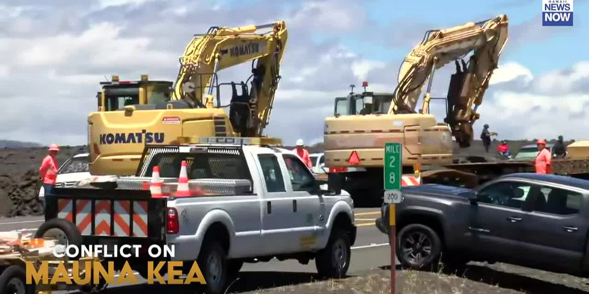 Construction crews stage on saddle road as protesters remain at base of Mauna Kea