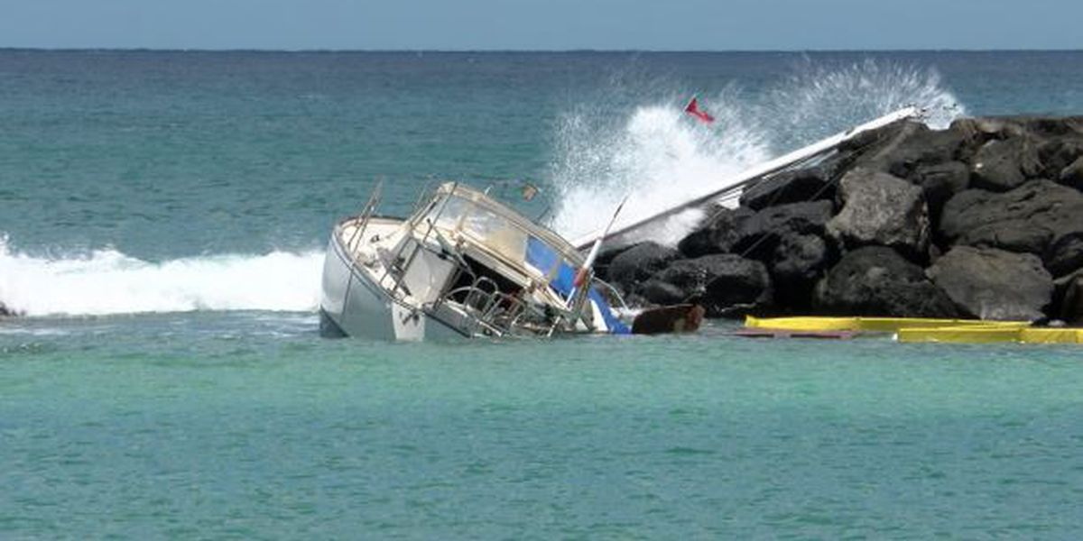 Swell hampers efforts to salvage sailboat that ran aground at Magic Island