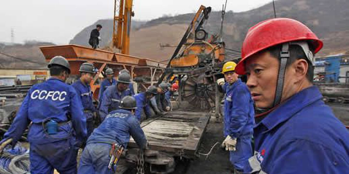 Race on to rescue 153 trapped Chinese coal miners