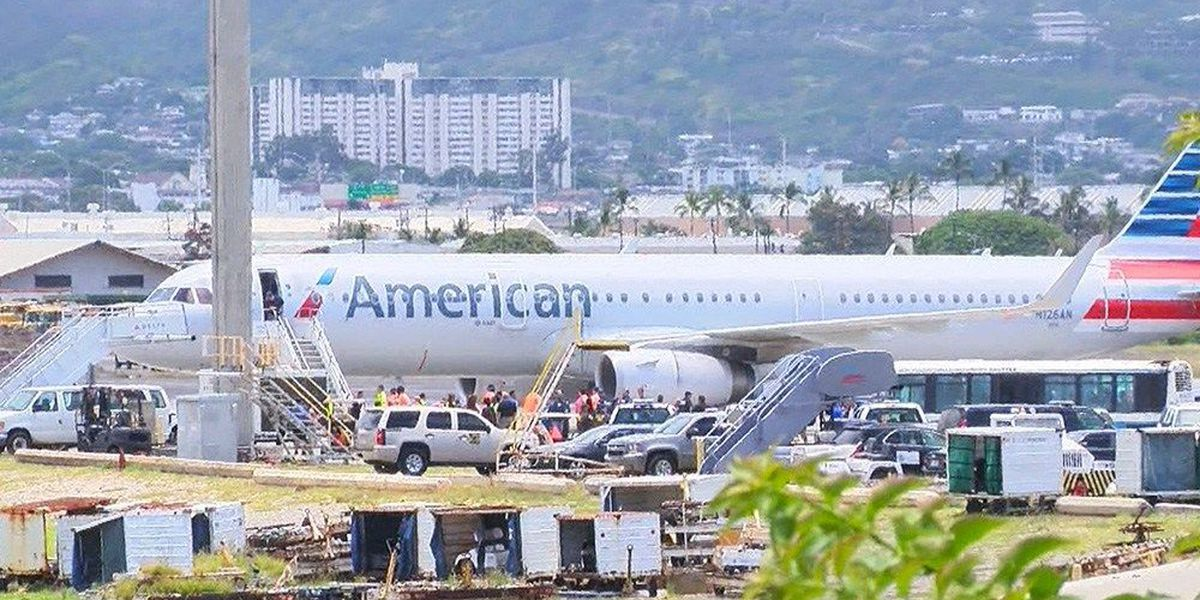 Passengers say detained man was unruly before flight even began