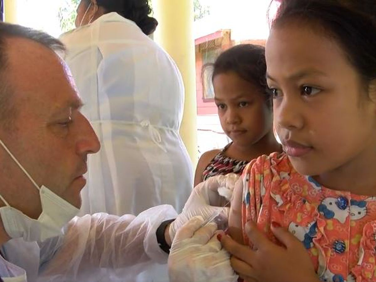 A year after mass vaccination effort in Samoa, Green says effort highlights scale of task ahead