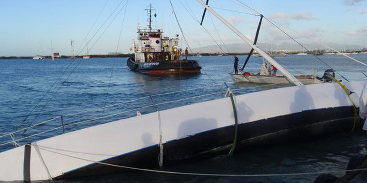 Salvage crews remove grounded sailboat