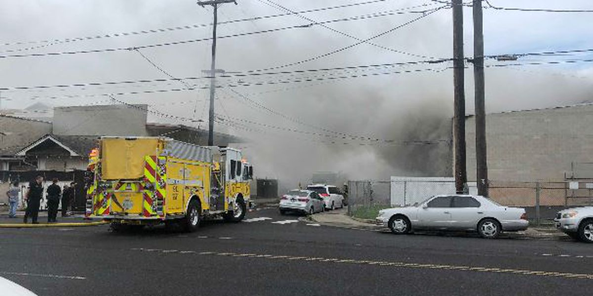 Dozens of firefighters douse blaze at Kalihi warehouse