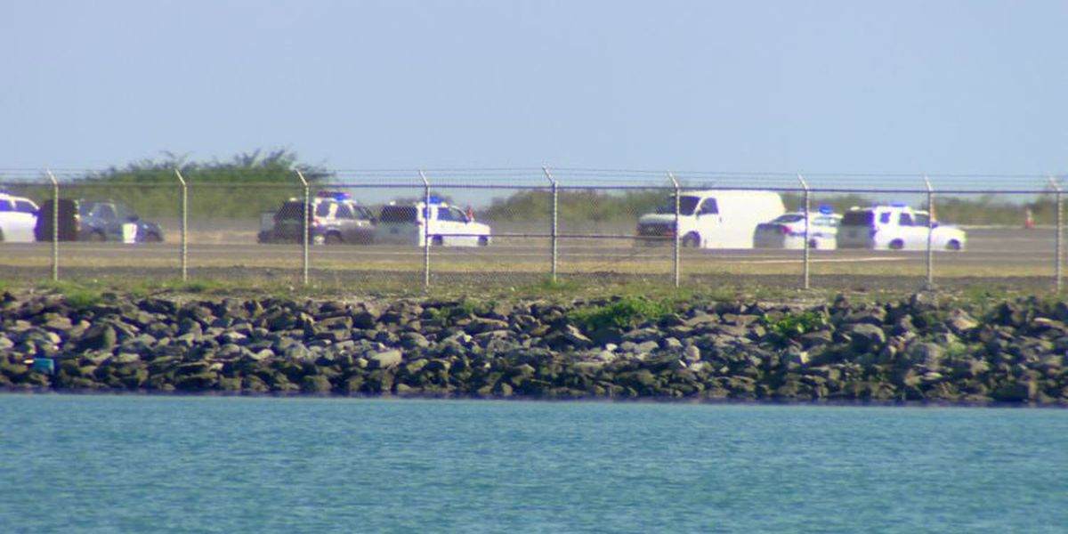 Investigation into body found near airport runway continues