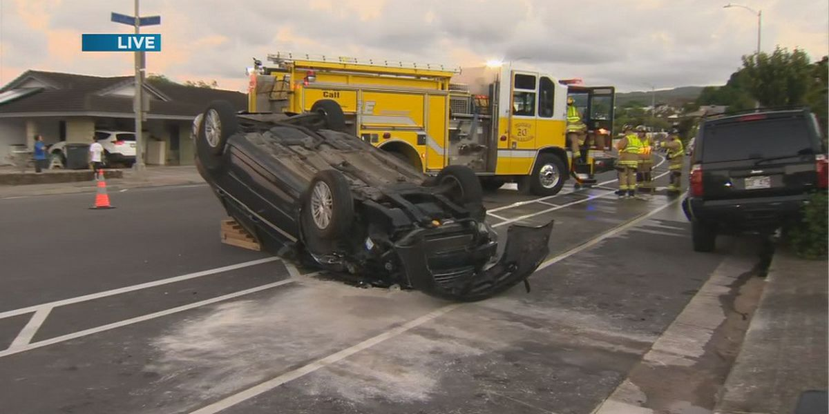 Overturned vehicle blocks lanes of Ala Napunani St. in Moanalua