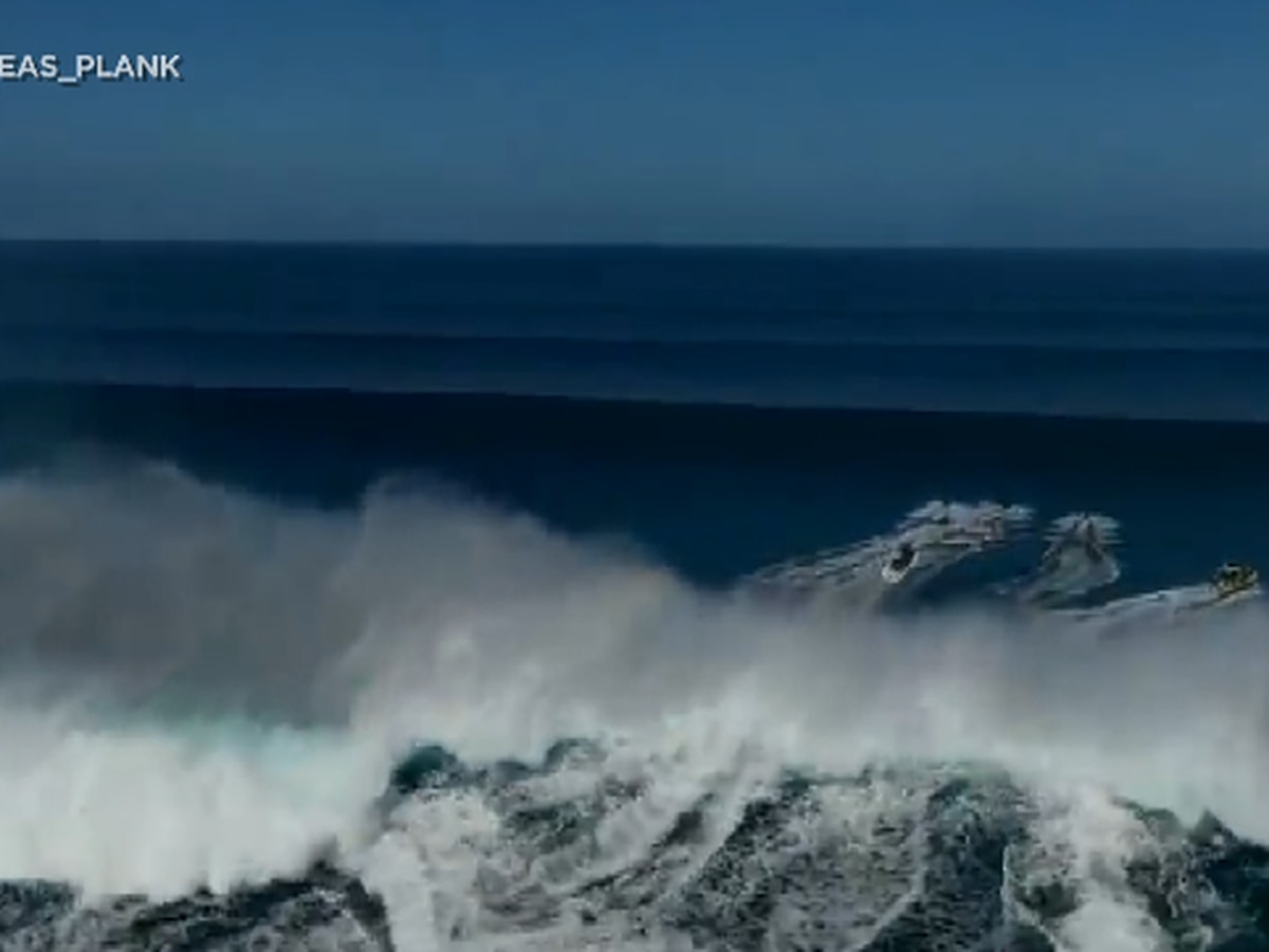 Jet skiers scramble to dodge a massive wave in this past weekend's impressive swell