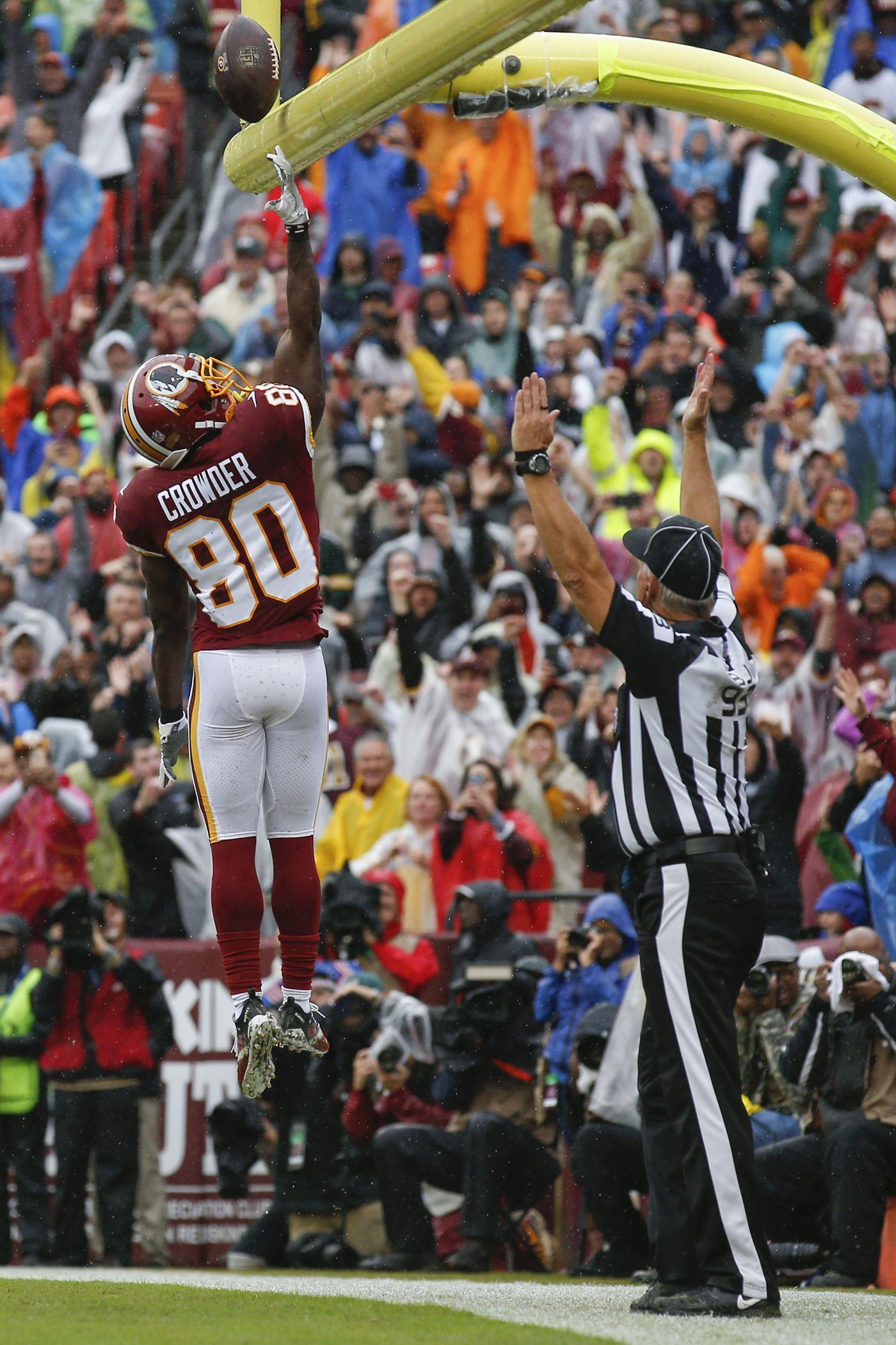 6bbaf5492 Washington Redskins wide receiver Jamison Crowder (80) tips the ball over  the goalposts as