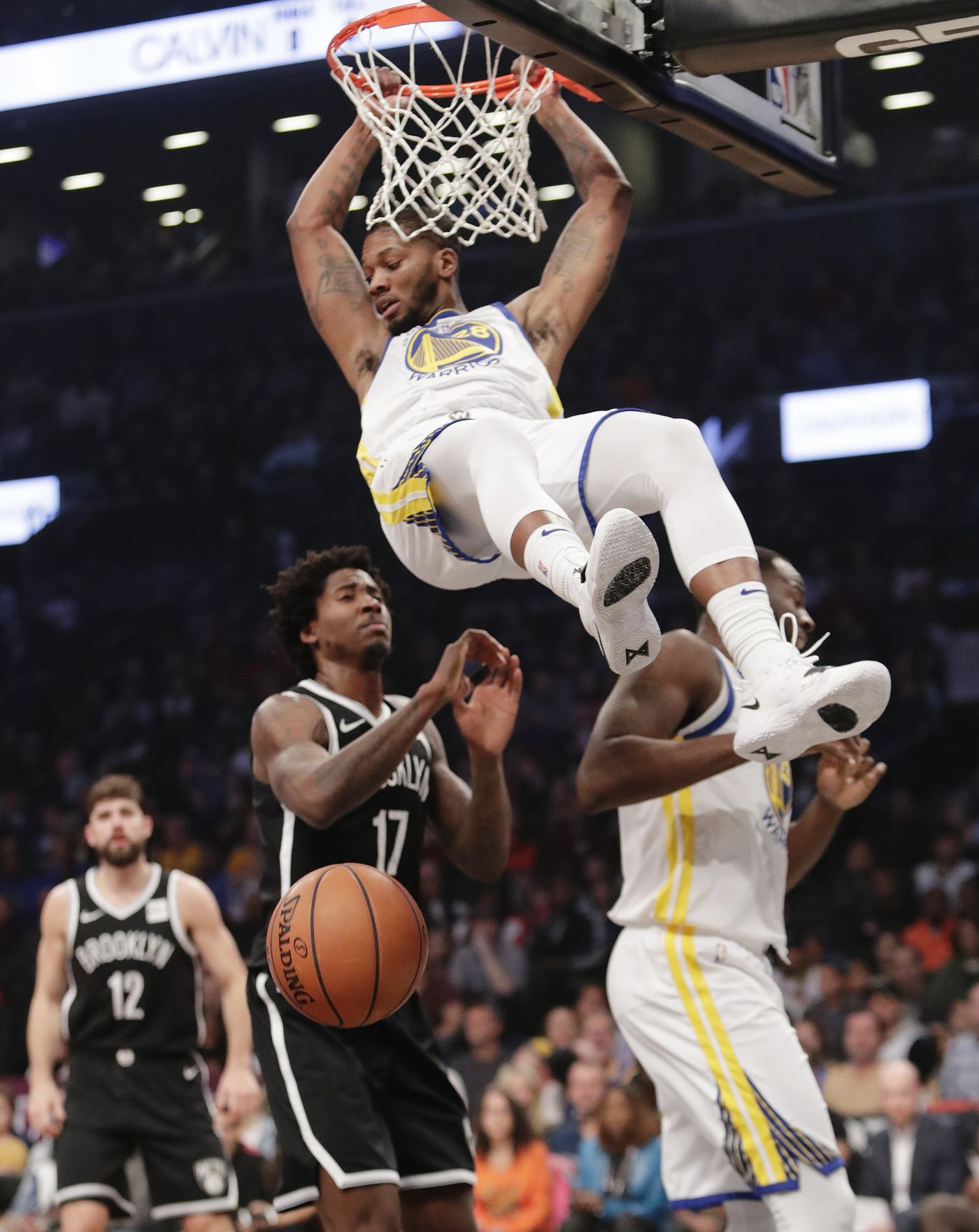 6d805a1ca410 Golden State Warriors  Alfonzo McKinnie (28) dunks the ball in front of  Brooklyn