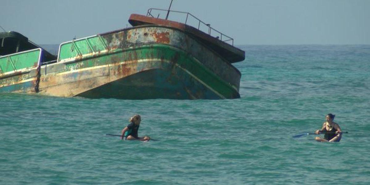 Yes, that big fishing vessel is still stuck off Waikiki