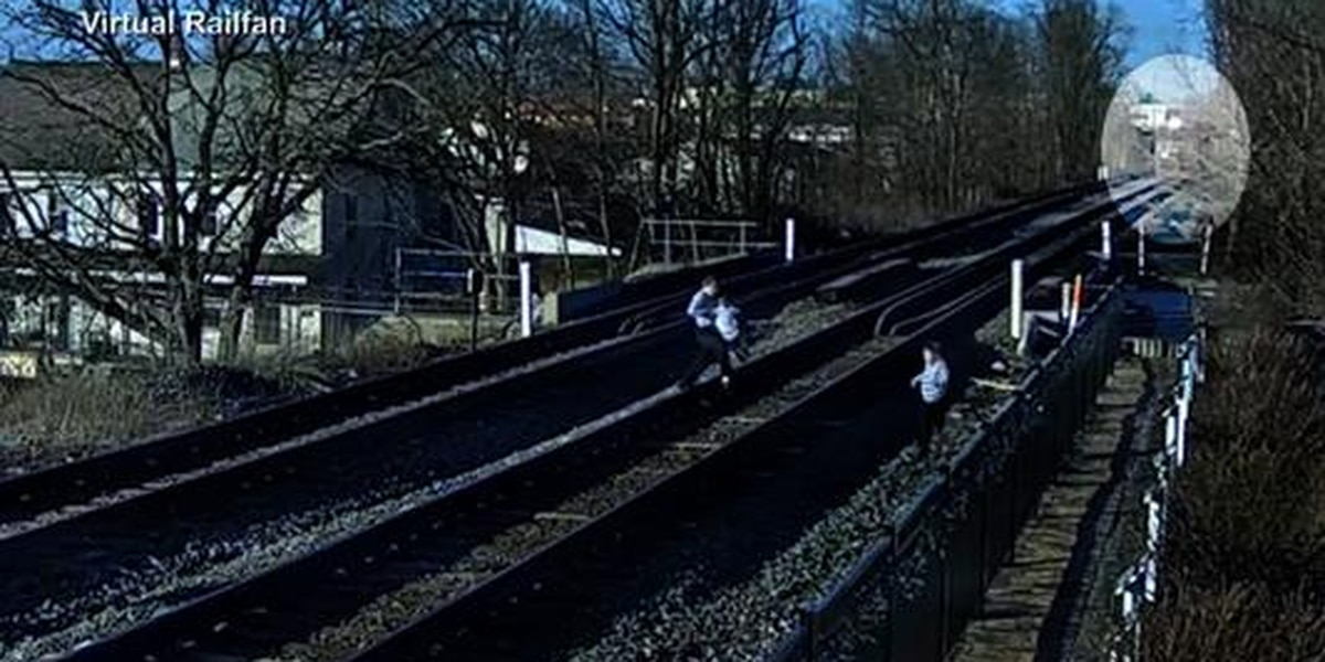 Family nearly hit by train