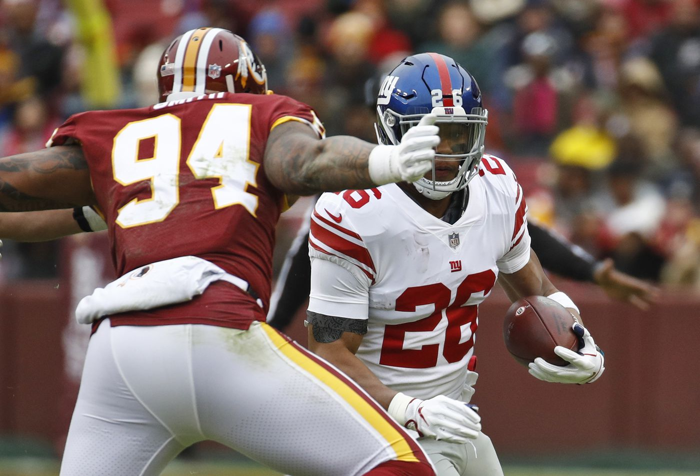 New York Giants running back Saquon Barkley (26) tries to get past  Washington Redskins aa16237dc