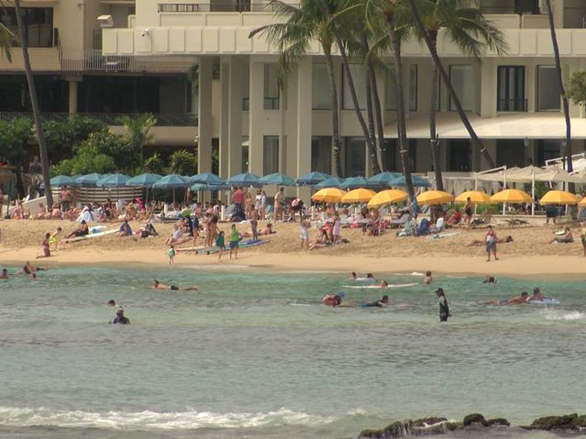 The Waikiki crowds are back, but tourism officials say it's anything but business as usual