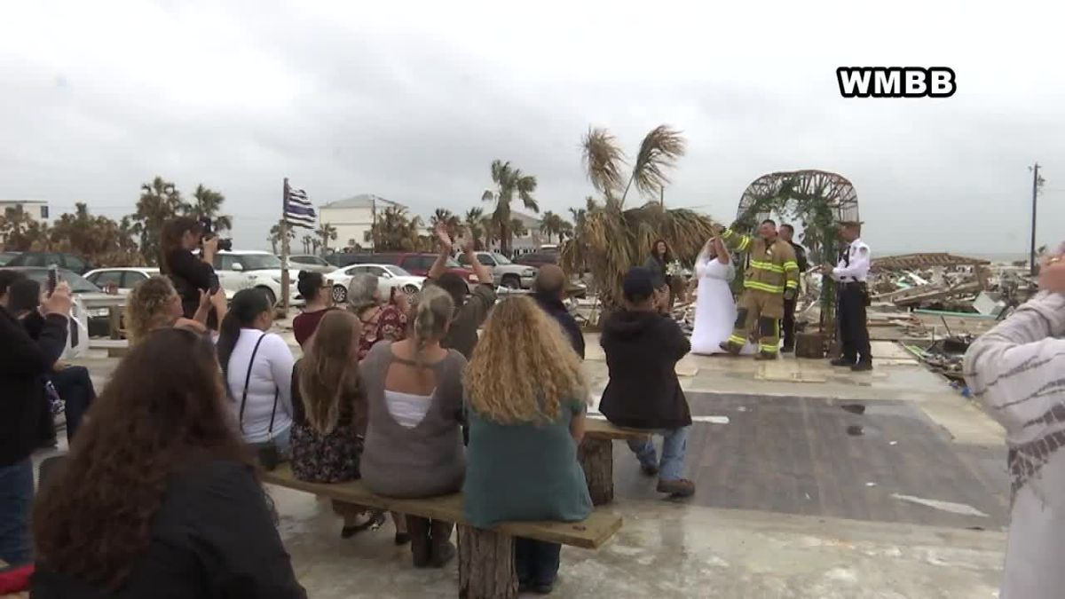 Hurricane Michael swept away bride's home - but not her wedding. She tied the knot on her home's slab