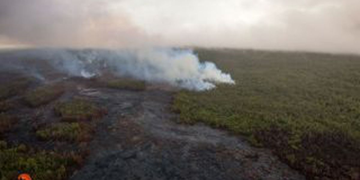 Puna lava flow breakouts upslope advancing about 275 yd/day, less than 3 miles from Apaa St