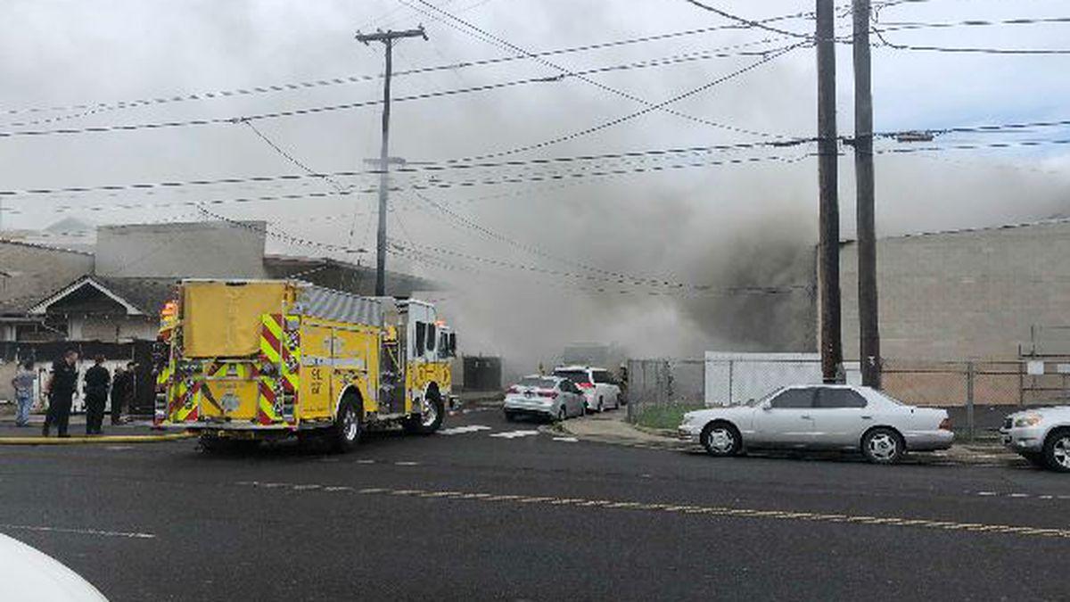 Dozens of firefighters douse blaze at Kalihi warehouse